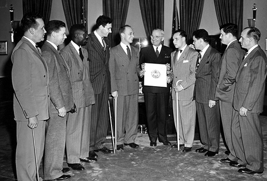 Included in the photograph from left to right are: Lloyd M. Greenwood, Executive Director, New York; Harrison King, Washington, D.C.; James W. Hope, Gastonia, N.C.; Raymond T. Frey, Past President, Le Banon, Pennsylvania; Byrum S. Shumway, of Board of Directors, Baltimore, Maryland; President Harry S. Truman; Irvin P. Schloss, Baltimore, Maryland; Robert Pistel, Chairman, Baltimore, Maryland, Group; Peter J. McKenna, Jr., Washington, D.C.; and John F. Brady, President, New York City.