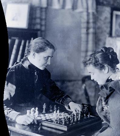 Helen Keller playing chess with Anne Sullivan.